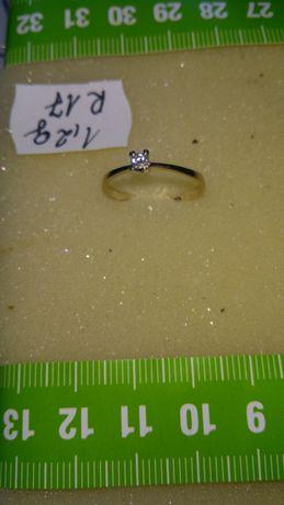 Pierścionek złoty z diamentami w cenie 1600 zł