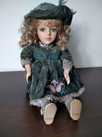 Kolekcjonerska lalka porcelanowa z pozytywką ruchoma