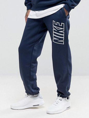 Теплые спортивные штаны Nike с большим логотипом