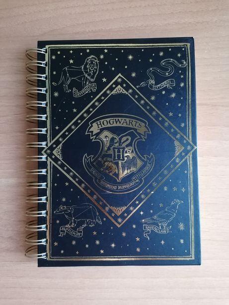 Caderno e borrachas Harry Potter