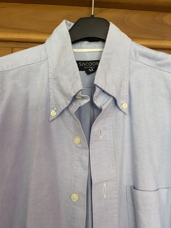 Camisa como nova Sacoor