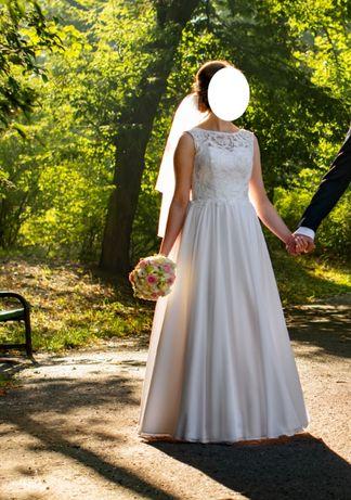 suknia ślubna jako materiał muślin koronka gorset wiązana biała