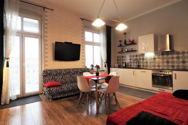 Apartament z balkonem dla firmy faktura Vat
