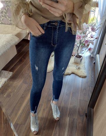 Genialne spodnie jeansowe push up z wysokim stanem przecierane
