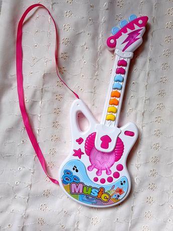 Музыкальная гитара.