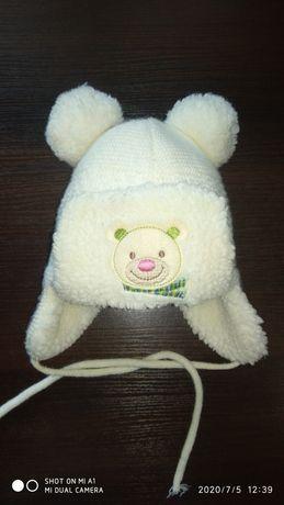 Продам зимнюю шапочку на ребенка до 1,5 годика