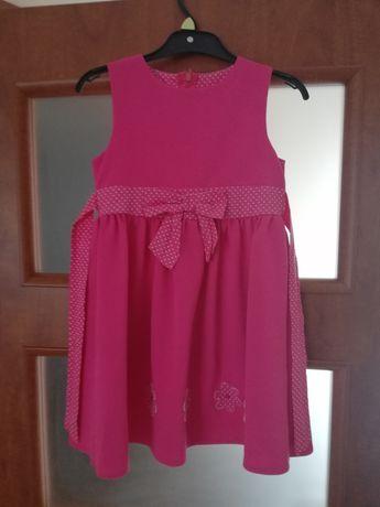 Sprzedam sukienkę rozmiar 122
