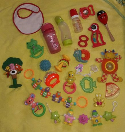 Перші іграшки для дитини, пляшечки, термо-чашка, пустушка з прищіпкою