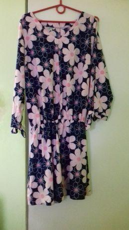 Sprzedam sukienke w kwiaty r.42