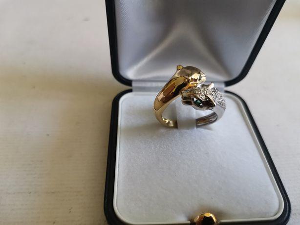 Witam sprzedam złoty pierścionek dwa lwy żółte i białe zloto