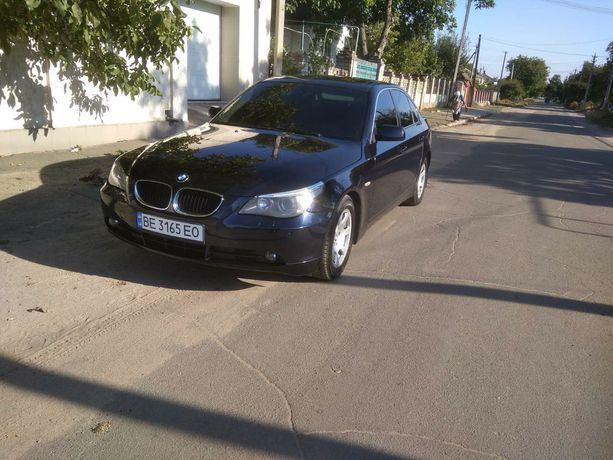 Машина BMW 520-Е60