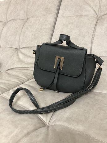Жіноча сумочка.