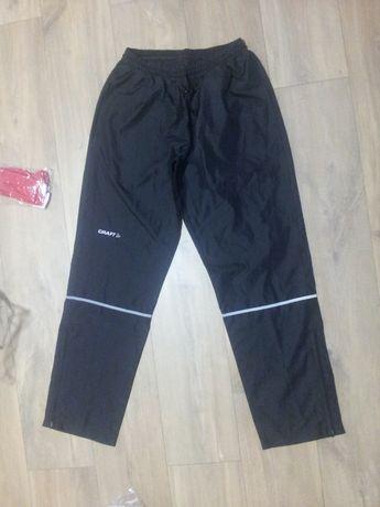 CRAFT ortaliony lekkie damskie spodnie wiatro i wodoodporne r M 38