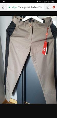 Brązowe spodnie z lampasami
