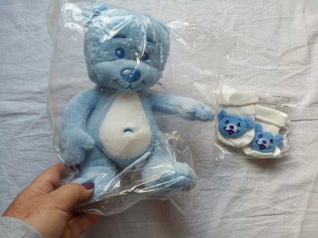 """Zestaw prezentowy dla niemowlaka: miś i misiowe skarpetki - """"Nivea""""."""