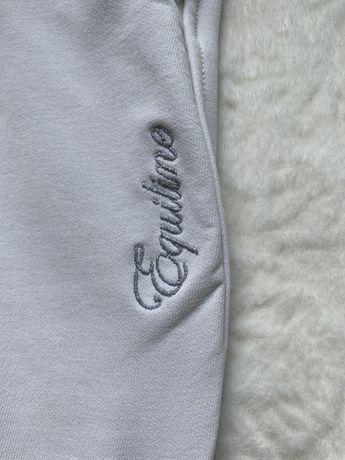 Białe bryczesy Equiline