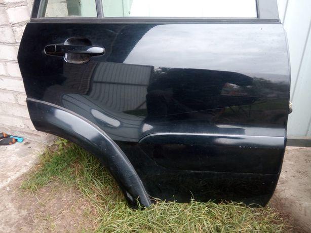Toyota RAV4 II 2005r fl drzwi prawe prawy tył kod 202  do założenia