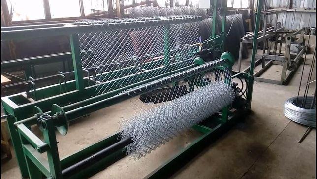Станок автомат для плетения сетки рабицы.