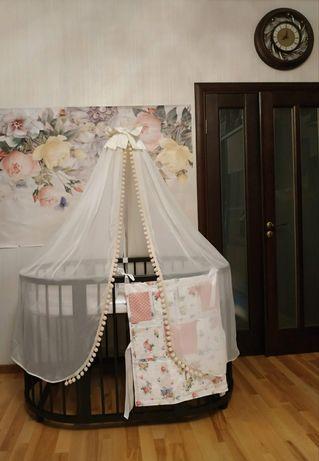 Овальная кроватка и пеленальный столик