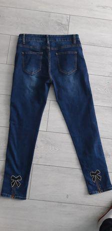 Spodnie jeansy 42 jak nowe