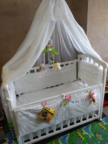 Детская кроватка-качалка в полном комплекте