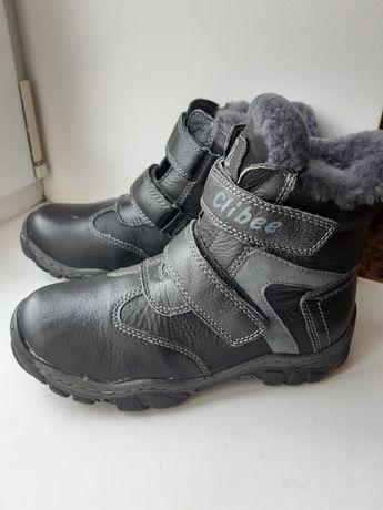 Нові зимові чобітки на хлопчика