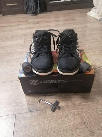 Продам роликовые кроссовки Heelys 38размер
