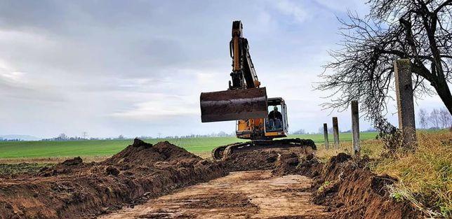 Prace ziemne koparka wywrotka drogi wyburzenia niwelacja rozbiórki