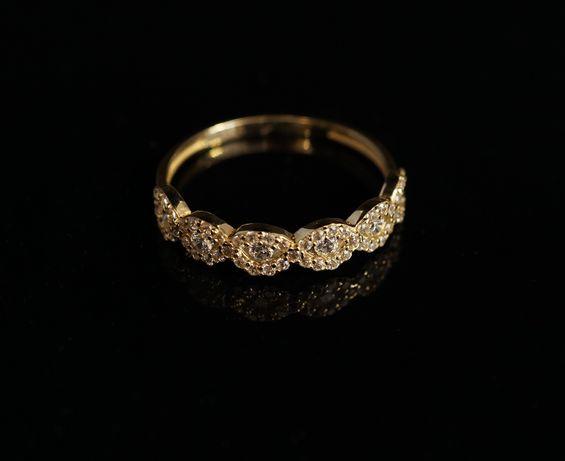 Złoto 585 - złoty pierścionek z cyrkoniami.