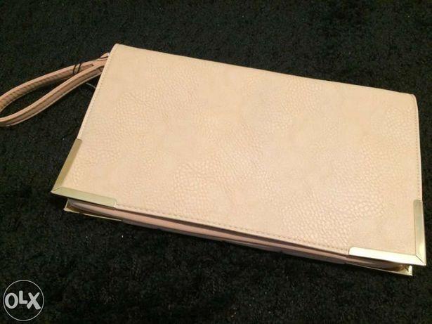 Vendo carteira de mão Nova
