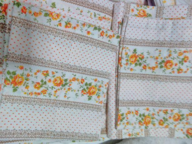 Dois conjuntos completos de lençóis um novo,e outro usado,bem preserva