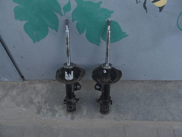 Стойки передние MANDO на HYUNDAI Accent, KIA Rio (2006-2010)