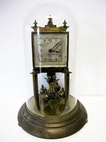 antigo Relógio anual de pêndulo rotativo com redoma em vidro