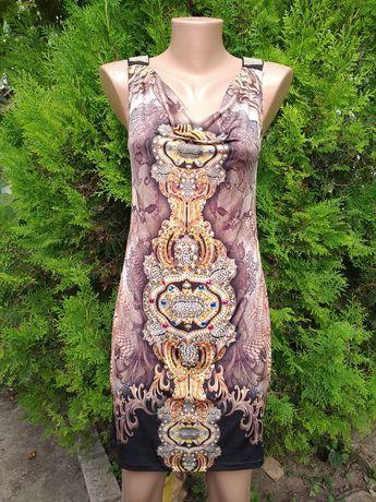 Оригинальное платье с камнями и открытой спинкой р. 42 44