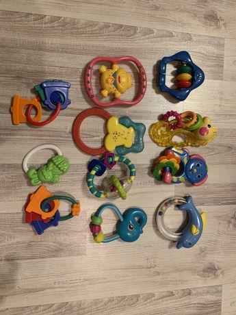 Grzechotki gryzaki dla niemowląt Fisher Price i inne