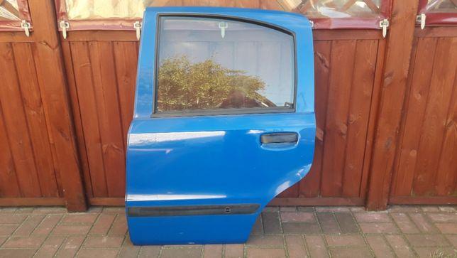 Drzwi Tył lewe do Fiata Pandy II KOMPLETNE kod lakieru. 734/A .
