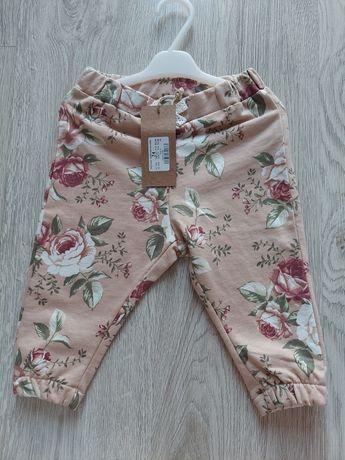 Spodnie w kwiaty newbie