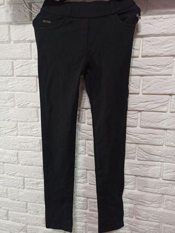 Продам черные брюки на флисе