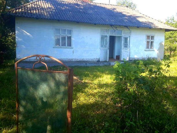 Продам будинок з земельною ділянкою в селі Крилос