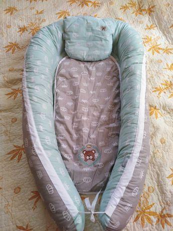 Кокон-позиціонер для немовляти