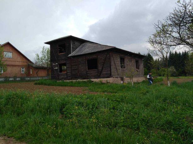 Продам землю, с недостроеным домом.