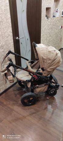 Дитяча коляска  і столик для годування