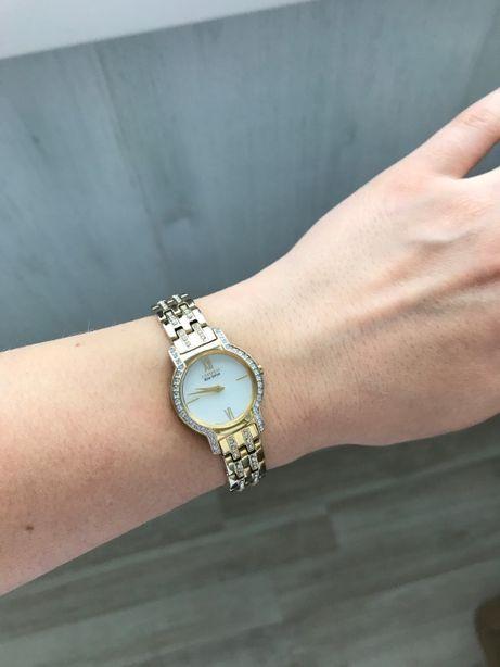 Женские часы Citizen Eco-Drive EX1242-56D.