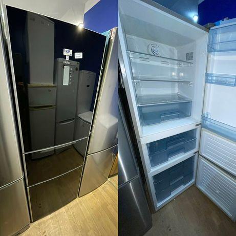 Холодильник чорного кольору Haier