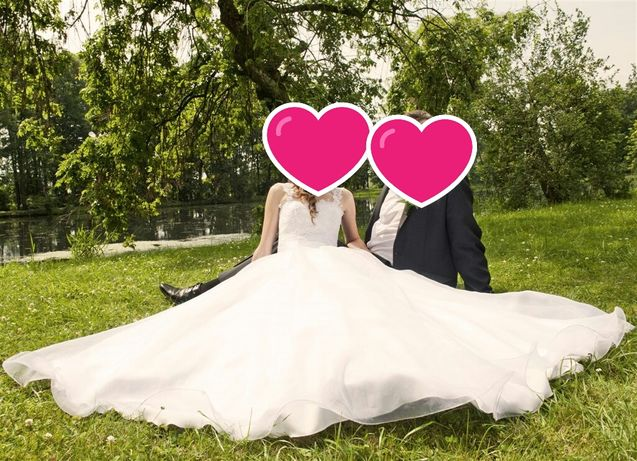 Suknia ślubna z trenem i welonem