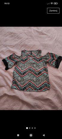 Wzorzysta bluzka z wyciętymi ramionami