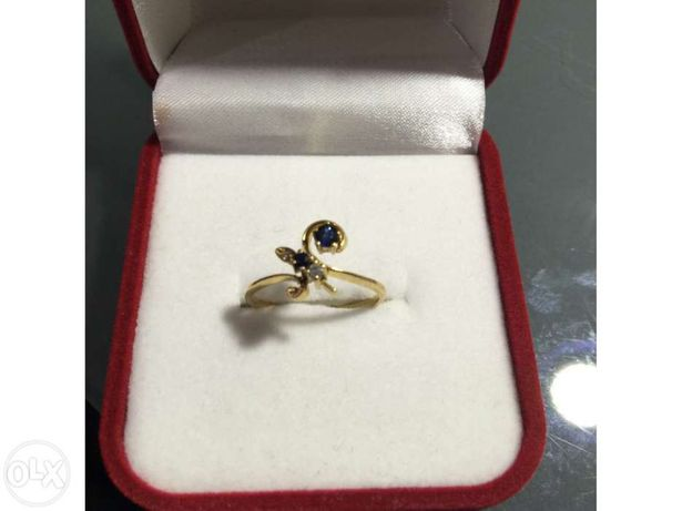 Anel em ouro de lei 800 ou 19.2kt com dois diamantes e duas safiras