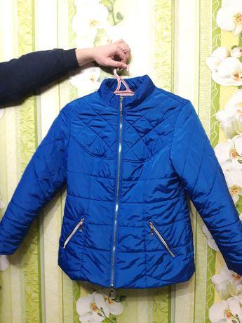 Продам весеннюю куртку для женщины р 50,52