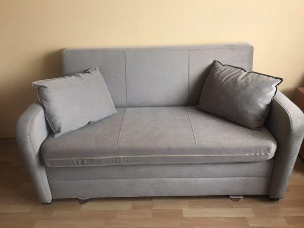 Beżowa sofa z funkcja spania