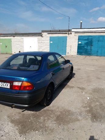 Продам автомобиль Mazda 323 1997 года выпуска